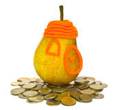 Concept of acquisition of the real estate. The Image of Pear on a heap of coins Royalty Free Stock Photos