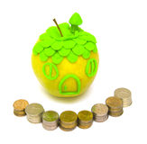 Concept of acquisition and real estate insurance. The Image of an apple and a fence from coins Stock Image
