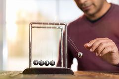 Concept For Action and Reaction in Business With Newton`s Cradle. Concept For Action and Reaction or Cause And Result in Business With Newton`s Cradle stock images