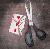 Concept of addiction, card with scissors Royalty Free Stock Images