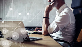 Concept of adult bearded businessman making a great business decisions in modern workplace.Screen global virtual icon. Diagram and graph interfaces.Horizontal Stock Photos