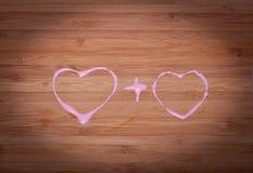 Concept affectueux de coeurs sur le bois Photo libre de droits