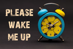 Concept,alarm clock with please wake me up phrase written on black background royalty free stock photos