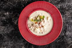 Concept of American cuisine. chowder potato soup with sea food, mussels, salmon. Fish broth soup with milk. The concept of American cuisine. chowder potato soup stock photo