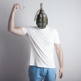 Concept of angry man. Creative portrait.  Grenade head. pulling the pin Stock Photos