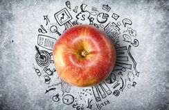 Concept with apple and business doodles Stock Photos