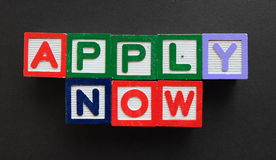 Concept of apply now. Alphabetical cubes showing the message of apply now Royalty Free Stock Image