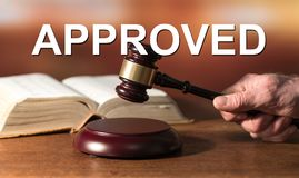 Concept of approval. With judge hammer and law book on background royalty free stock photography