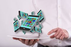 Concept of apps. Apps concept above a tablet held by a man in background royalty free stock images