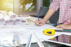 Concept architects.engineer holding pen pointing. royalty free stock images