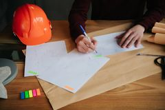 Concept architects,engineer holding pen pointing equipment architects On the desk with a blueprint in the office stock images