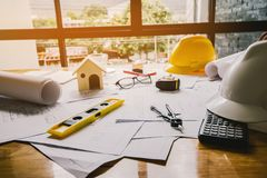 Concept architects, equipment architects On the desk with a blueprint in the office, Vintage, Sunset light. Selective Focus stock photo