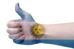 The concept of Argentina-the hand gives a thumbs up with the flag of Argentina. The hand and the flag of Argentina royalty free stock images
