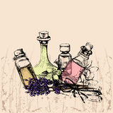 The concept of aromatherapy and massage with four bottles of ess Stock Images