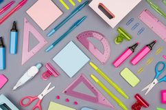 Concept art stationery background for designers - colored office accessories on grey desk backdrop. Concept art stationery background for designers - colored stock image
