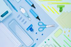 Concept art stationery background for designers - colored office accessories on soft light blue, neon mint backdrop. Concept art stationery background for royalty free stock photo