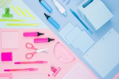 Concept art stationery background for designers - colored office accessories on soft light blue, pink, neon mint backdrop. Concept art stationery background for stock images