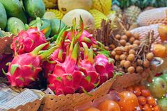 Concept asian food market. Dragon fruit Pitahaya and Dragon eye Longan on counter street night vendor of fruits. Exotic fruits Stock Image