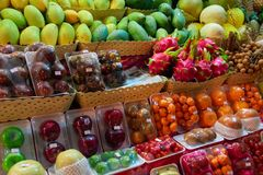 Concept asian food market street night vendor of fruits. Exotic tropical fruits. Royalty Free Stock Image