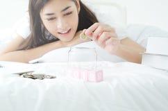 Concept of Asian people saving money stock photos
