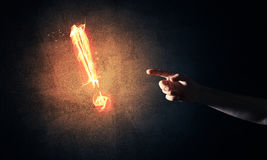Concept of attention or punctuation with burning exclamation mar Stock Photo