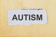 Concept for autism awareness. Cut out newspaper on a vintage paper Royalty Free Stock Image