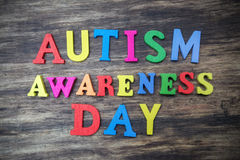 Concept of autism awareness day word. On wooden background Stock Photo