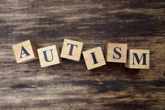 Concept of autism word on wooden cubes Royalty Free Stock Photo