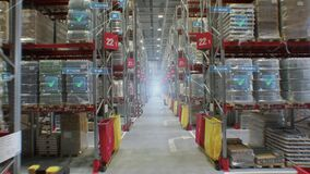 Concept of automation and digitalization of warehouse. A fly-through of product rows with infographics and digital