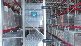 Concept of automation and digitalization of warehouse. Panorama parallel shot of product rows with infographics and