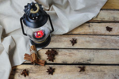 Concept autumn cosiness. Autumn comfort concept, still life of candlestick, cinnamon and star anise royalty free stock photos