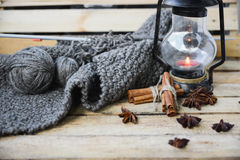 Concept autumn cosiness. Autumn comfort concept, still life of candlestick and knitting royalty free stock photography