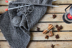 Concept autumn cosiness. Autumn comfort concept, still life of candlestick and knitting royalty free stock photo