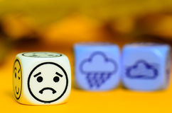 Concept of autumn weather - emoticon and weather dice on orange Royalty Free Stock Image