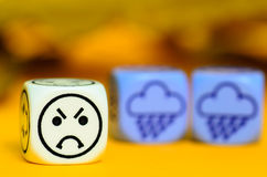 Concept of autumn weather - emoticon and weather dice on orange Stock Photo