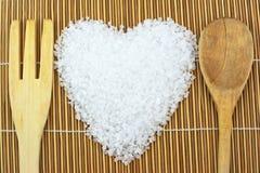 Concept avec du sel, la cuillère et la fourchette de mer Photo libre de droits