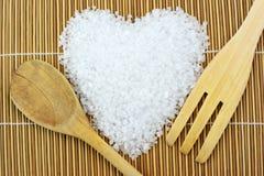 Concept avec du sel, la cuillère et la fourchette de mer Images stock