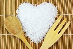 Concept avec du sel, la cuillère et la fourchette de mer Photographie stock