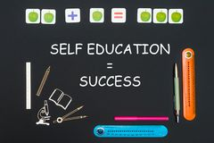 Above stationery supplies and text self education success on blackboard. Concept back to school, above stationery supplies and text self education success on Stock Images