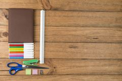 School supplies on some wooden boards. Concept of back to school. School supplies on some wooden boards royalty free stock images