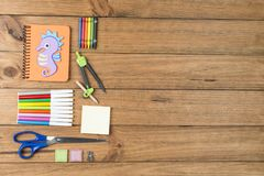 School supplies on some wooden boards. Concept of back to school. School supplies on some wooden boards stock photos