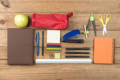 School supplies on some wooden boards. Concept of back to school. School supplies on some wooden boards royalty free stock photography