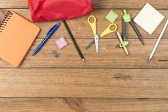 School supplies on some wooden boards. Concept of back to school. School supplies on some wooden boards royalty free stock image