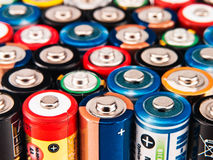 Concept background of colorful batteries. Background of many colorful batteries Stock Photography