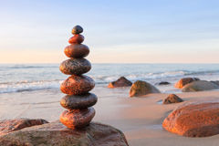 Concept of balance and harmony. Rock Zen at sunset. Stock Photography
