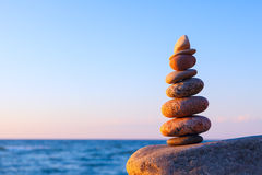 Concept of balance and harmony. stones balance on the background of the sea Stock Images