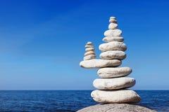 Concept of balance and harmony. White rocks zen on the sea. Royalty Free Stock Photo