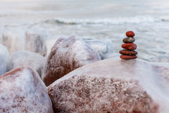 Concept of balance and harmony. Winter rock Zen. Stock Image