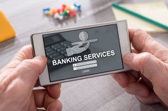 Concept of banking services. Banking services concept on mobile phone stock images
