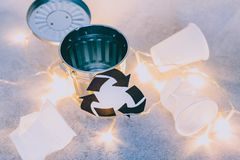 Disposable cups and garbage bin with recycle symbol, concept of reducing single-use plastic royalty free stock photo